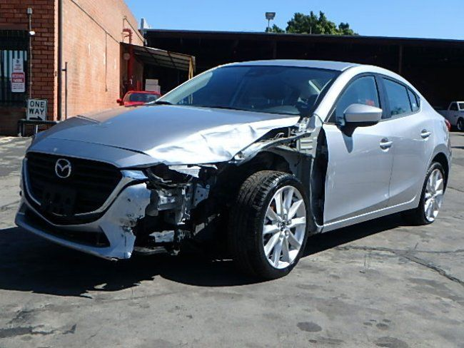 left front hit 2017 Mazda Mazda3 Touring repairable