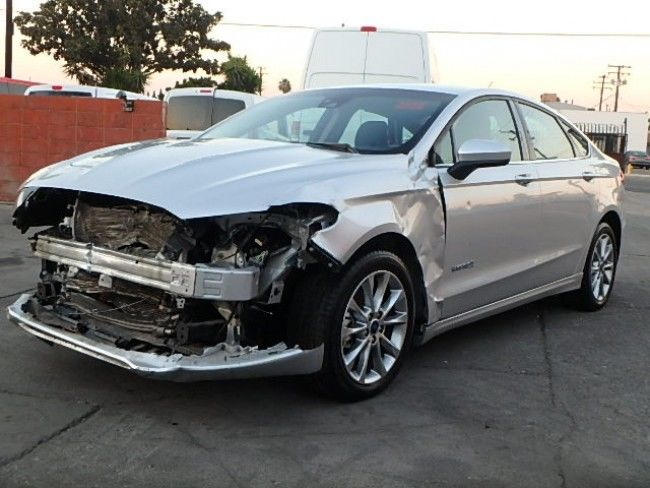 front hit 2015 Ford Fusion Hybrid SE repairable