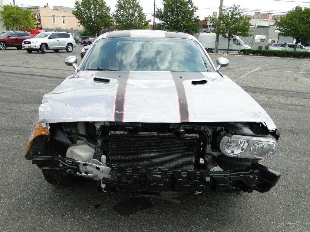 low miles 2014 Dodge Challenger HEMI repairable