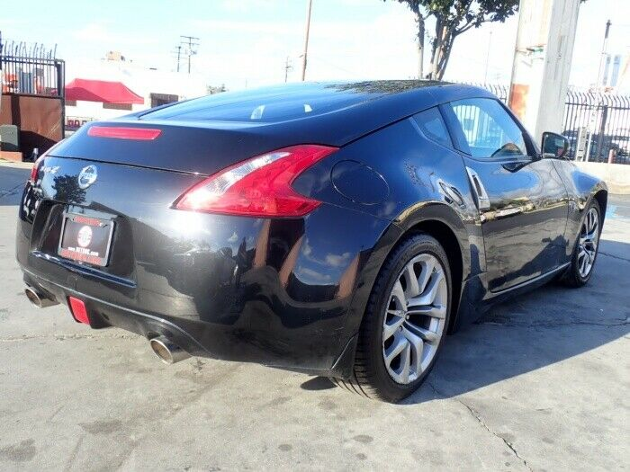 low miles 2013 Nissan 370Z Touring Coupe repairable