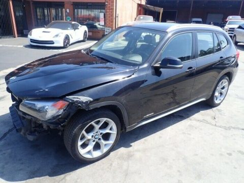front damage 2014 BMW X1 Xdrive28i AWD repairable for sale