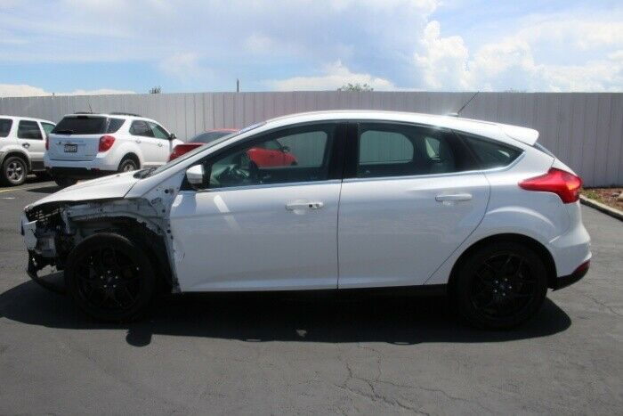 low miles 2016 Ford Focus Titanium repairable
