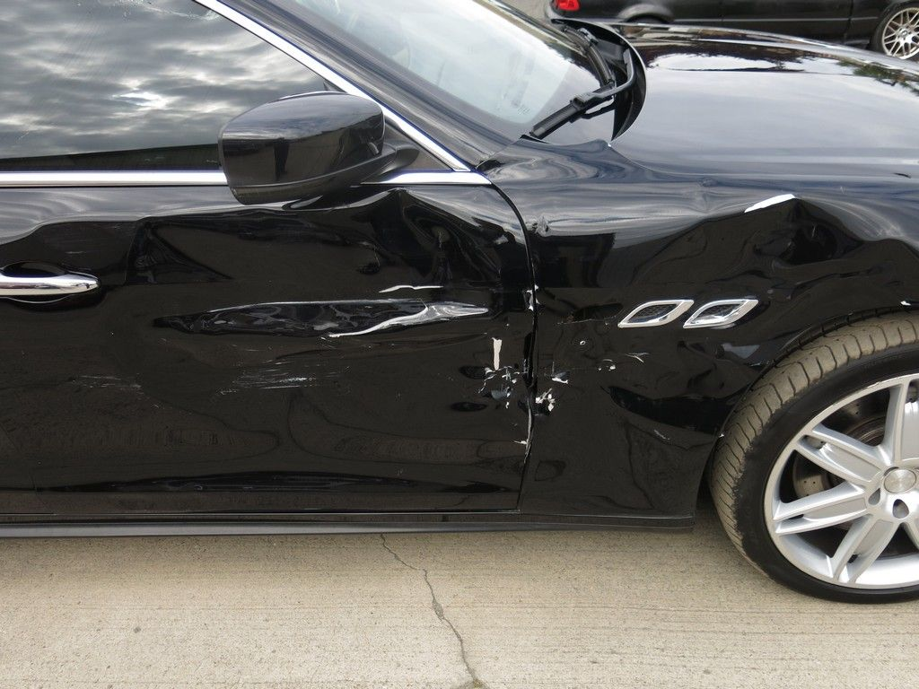 light damage 2014 Maserati Quattroporte GTS repairable